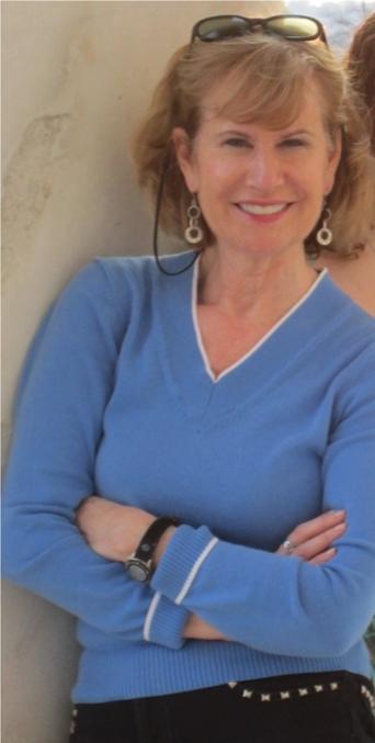 Alice V. McKenna in blue, standing