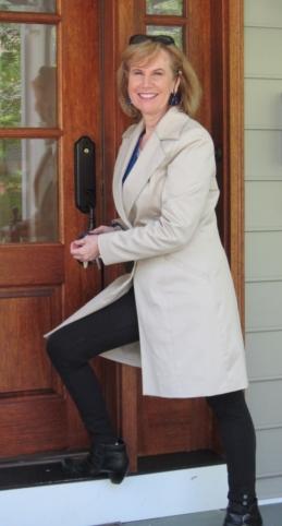 Alice V. McKenna at wooden door, full body.