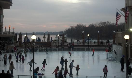 Ice skaters at Georgetown waterfront, night