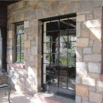 Silver Spring House With Tudor Stone Arch